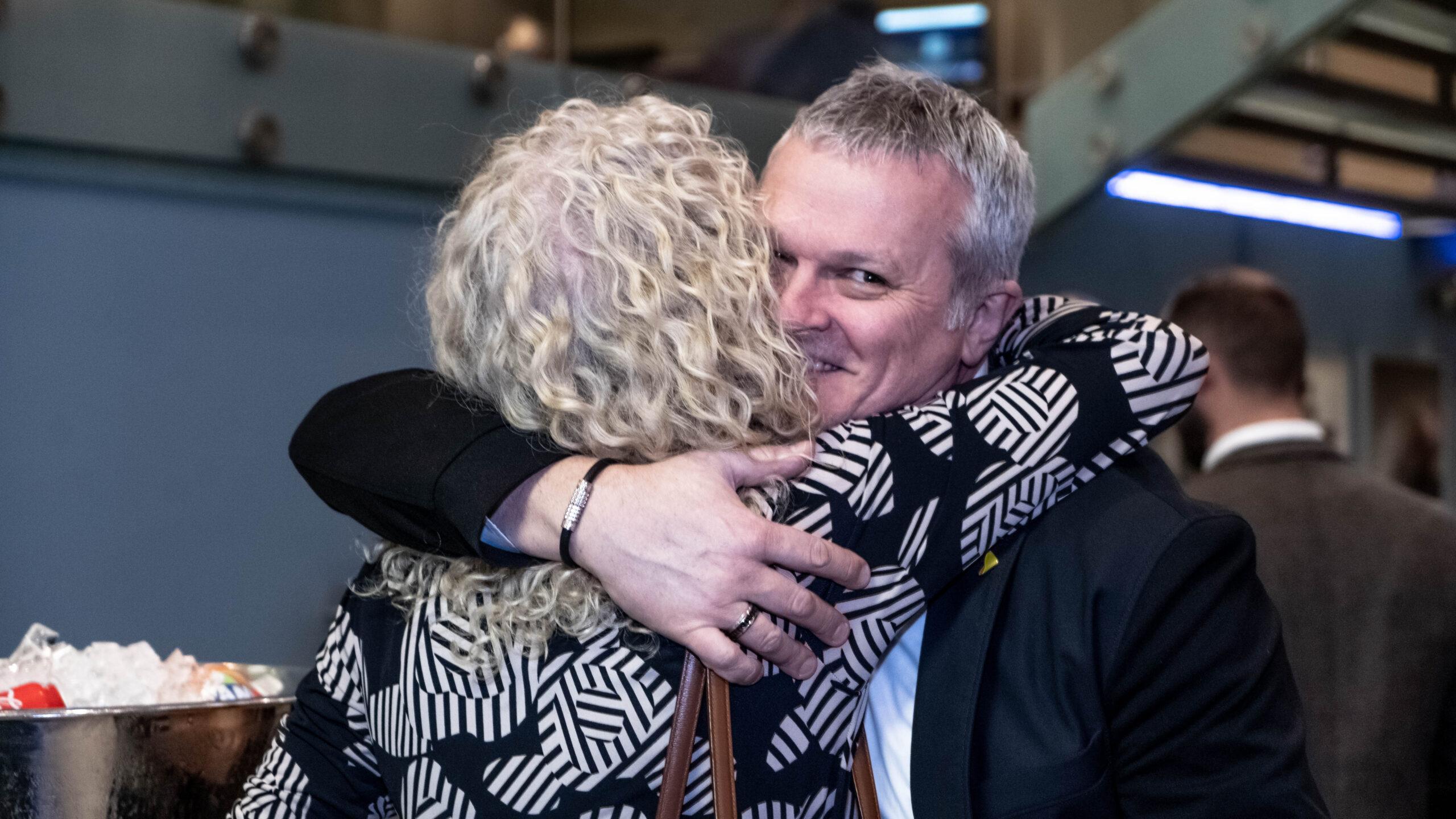 Alistair Hugging a women