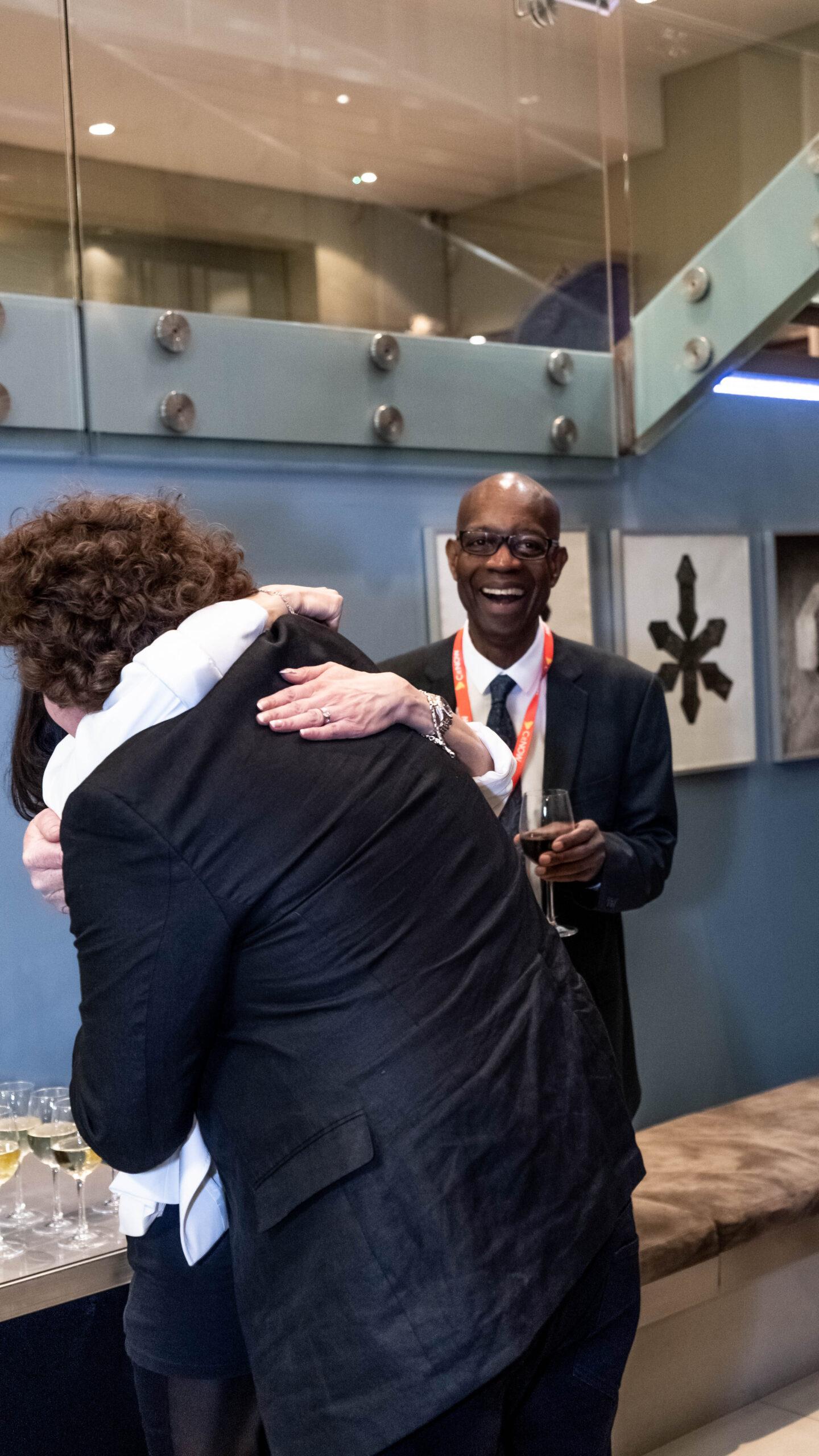 Georfer hugging a woman