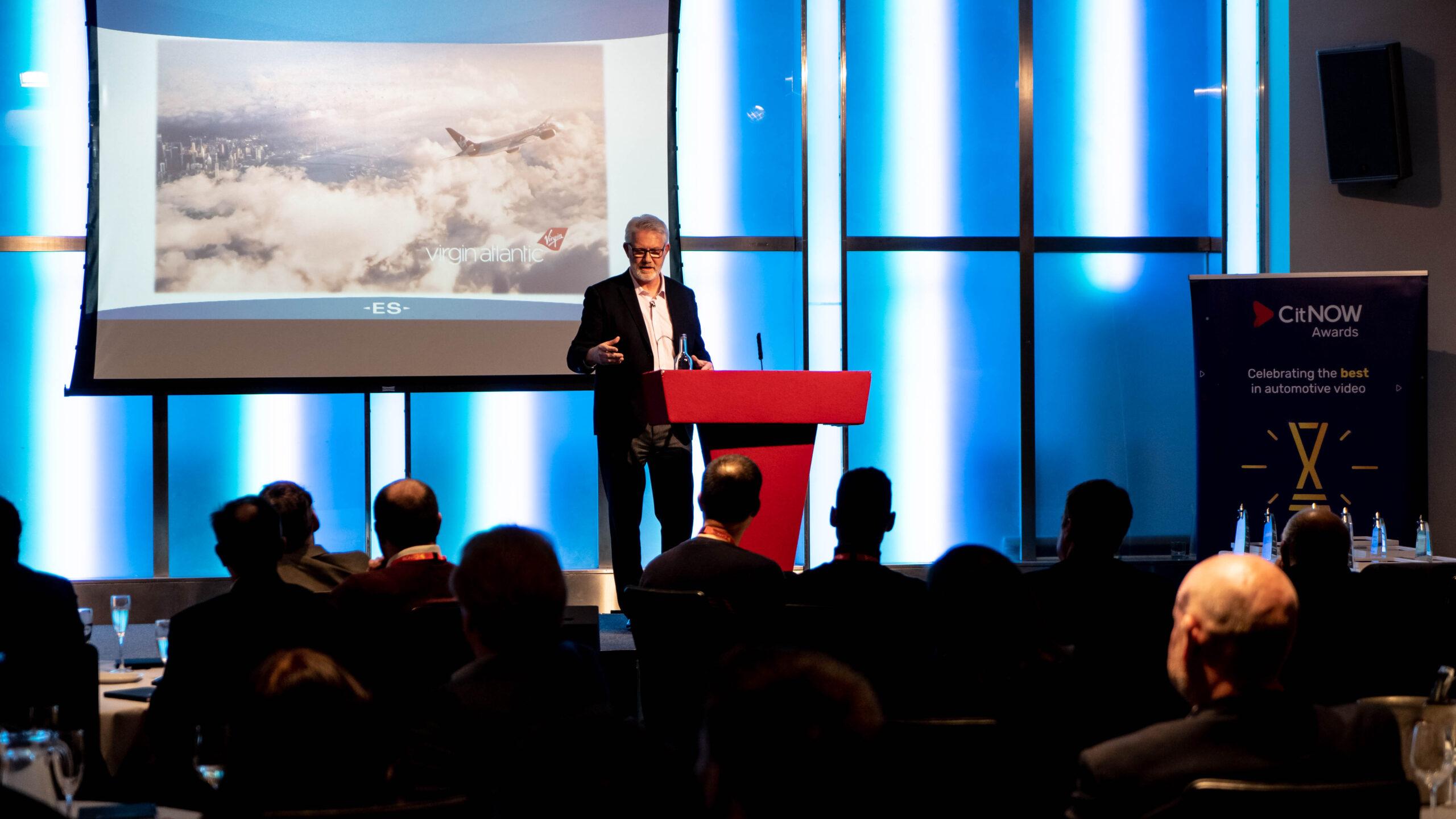 Event speaker on stage